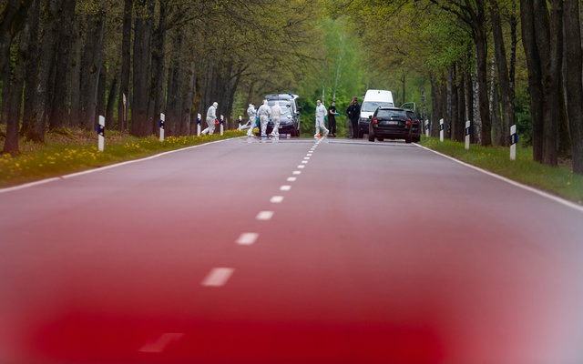 In a wooded area not far from Bispingen, police officers secure traces at the site of a child's body on a federal highway that has been closed off with barrier tape. A woman and her four-year-old son were discovered dead in a house in Bispingen on May 16. Both had shown traces of violence, police and public prosecutor's office announced. The eleven-year-old daughter was missing. REUTERS