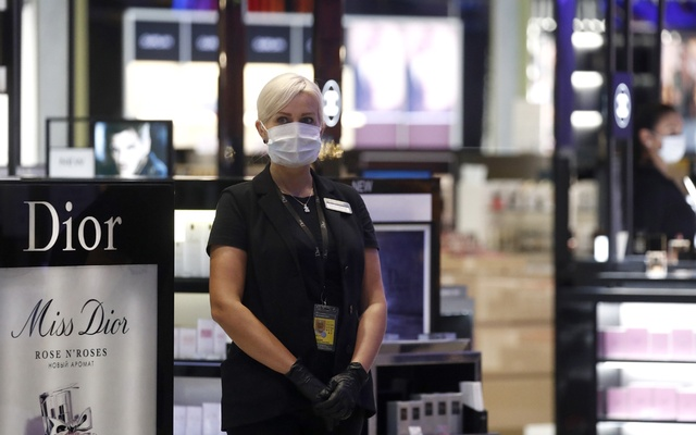 An employee of Sheremetyevo Duty Free Heinemann at the relaunched international terminal C of Sheremetyevo International Airport. It was closed in Mar 2020 due to air travel restrictions imposed amid the COVID-19 pandemic. REUTERS