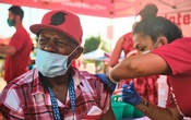 A person receives a dose of a COVID-19 vaccine near Portland, Ore., on July 22, 2021. The US vaccine rollout has plateaued and the course of the coronavirus pandemic in this country may depend on how many people are ultimately swayed to get vaccinated. (Tojo Andrianarivo/The New York Times)