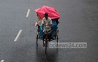 A rickshaw driver plies his trade on Dhaka's Sobhanbag Road on Saturday, July 24, 2021 as passengers take cover from the rain underneath a tarp. A low-pressure weather system has caused heavy rain in Dhaka over the past few days. Photo: Asif Mahmud Ove