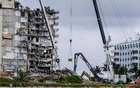 Search and rescue personnel search rubble of the partially collapsed Champlain Towers South condo building in Surfside, Fla, Tuesday, June 29, 2021. The search at the collapse site in Surfside, Fla., was declared over on Friday, July 23, but the authorities are continuing to look through the relocated rubble for the remains of Estelle Hedaya, 54. (Maria Alejandra Cardona/The New York Times)