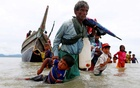 Representational image: A Rohingya refugee man pulls a child as they walk to the shore after crossing the Bangladesh-Myanmar border by boat through the Bay of Bengal in Shah Porir Dwip, Bangladesh, September 10, 2017. Danish Siddiqui, Reuters