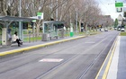 A lone passenger sits at a tram stop on a mostly-empty city centre street on the first day of a lockdown as the state of Victoria looks to curb the spread of a coronavirus disease (COVID-19) outbreak in Melbourne, Australia, July 16, 2021. REUTERS