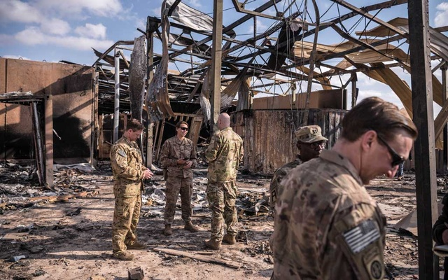US military personnel on Monday, Jan 13, 2020, survey the damage to a building at Ain al-Asad Air Base in Anbar, Iraq that was struck by Iranian missiles. The New York Times
