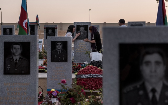 Relatives of fallen soldiers visit the military cemetery in Baku, Azerbaijan, June 26, 2021. The New York Times