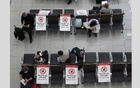 Passengers wait on socially distanced chairs at Heathrow Airport amid the coronavirus disease (COVID19) pandemic in London, Britain July 7, 2021. REUTERS