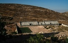 An unfinished soccer stadium in Wadi al-Nis, in the West Bank, July 22, 2021. The New York Times.