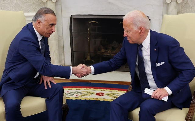 US President Joe Biden greets Iraq's Prime Minister Mustafa Al-Kadhimi during a bilateral meeting in the Oval Office at the White House in Washington, US, July 26, 2021. REUTERS