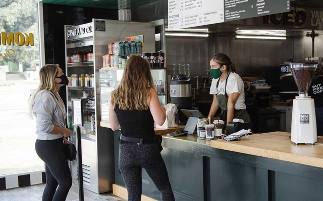 At a coffee shop last week after Los Angeles County reimposed an indoor mask mandate for everyone, regardless of vaccination status.Credit...Morgan Lieberman for The New York Times