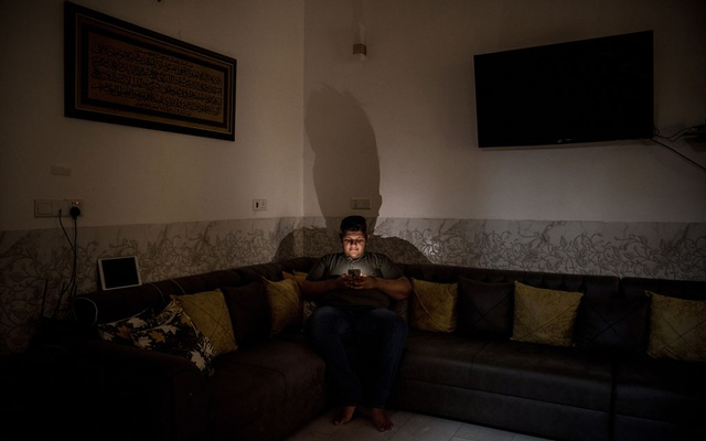 Ali Adil at his home in Hilla, Iraq, on July 24, 2021. In Iraq, the fame of going viral has come with the threat of violence. (Sergey Ponomarev/The New York Times)