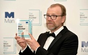George Saunders, author of 'Lincoln in the Bardo', poses for photographers after winning the Man Booker Prize for Fiction 2017 in London, Britain, October 17, 2017. REUTERS