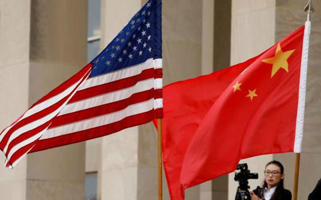 US and Chinese flags are seen before a meeting between senior defence officials from both countries at the Pentagon in Arlington, Virginia, US, November 9, 2018. REUTERS/Yuri Gripas/File Photo