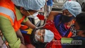 Suspected coronavirus patient Shipra, who gave a single name and also has typhoid, is carried into an autorickshaw for transfer from Dhaka Medical College Hospital to Sir Salimullah Medical College Hospital after arriving from Bogura on Wednesday, Jul 28, 2021. Photo: Mahmud Zaman Ovi