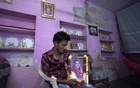 Vishal Meghwal looks at a photograph of his mother who died of COVID-19 in May this year at his home in Ajmer, India. June 24, 2021. Thomson Reuters Foundation/Deepak Sharma