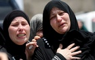 The mother of Palestinian Mohammed Al-Tamimi, who was killed by Israeli forces during clash on Friday, according to officials, mourns during his funeral in Deir Nidham in the Israeli-occupied West Bank on July 24, 2021. REUTERS