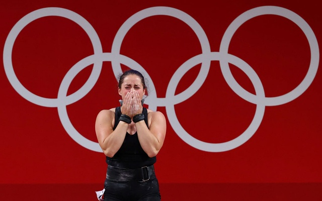 Maude Charron of Canada celebrates after a lift. Tokyo 2020 Olympics - Weightlifting - Women's 64kg - Group A - Tokyo International Forum, Tokyo, Japan - July 27, 2021. REUTERS