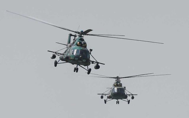 Military helicopters fly during a large military exercise entitled