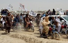 People on vehicles, holding Taliban flags, gather near the Friendship Gate crossing point in the Pakistan-Afghanistan border town of Chaman, Pakistan July 14, 2021. REUTERS/Abdul Khaliq Achakzai