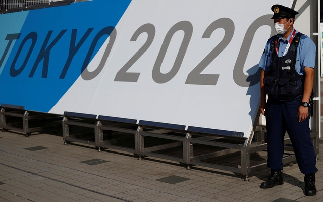 A police officer wearing a face mask stands near the entrance of the Main Press Centre, ahead of the Tokyo 2020 Olympic Games, in Tokyo, Japan, July 19, 2021. REUTERS
