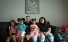 Kathryn Goodwin with her children at their home in Saint Charles, Mo, on July 25, 2021. From left: Aliyah, 6; Vivian, 3; Xavier, 5; Evelyn, 2; and Chloe, 11. (Sarahbeth Maney/The New York Times)