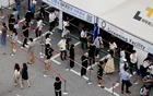 People wait in line for a coronavirus disease (COVID-19) test at a testing site which is temporarily set up at a public health centre in Seoul, South Korea, July 9, 2021. REUTERS