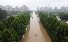 An aerial view shows a flooded road following heavy rainfall in Zhengzhou, Henan province, China July 23, 2021. Picture taken with a drone. REUTERS