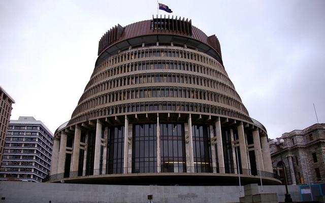A pedestrian walks past the New Zealand parliament building known as the Beehive in central Wellington, New Zealand, July 3, 2017. Picture taken on July 3, 2017. REUTERS