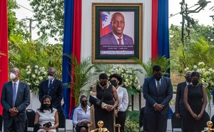 Martine Moïse, the first lady of Haiti, centre, at a memorial for her assassinated husband, President Jovenel Moïse, in Port-au-Prince on July 20, 2021. In her first interview since the president's assassination on July 7, Martine Moïse described the searing pain of witnessing her husband, a man with whom she had shared 25 years, being killed in front of her. (Federico Rios/The New York Times)