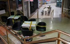 Tables marked with caution tape to prevent people from sitting are seen in an empty city centre mall during a lockdown to curb the spread of COVID-19 outbreak in Sydney, Australia, July 28, 2021. REUTERS