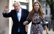 Britain's Prime Minister Boris Johnson and partner Carrie Symonds arrive at a Westminster polling station to vote, in London, Britain May 6, 2021. REUTERS/Henry Nicholls