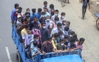 Pickup vans, packed with passengers on the Dhaka-Chattogram Highway, entered Dhaka through Shonir Akhra on Saturday, Jul 31, 2021 after the government allowed export-oriented factories to reopen amid the coronavirus lockdown. Photo: Asif Mahmud Ove