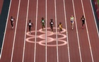 Women compete in a 100m qualifying round on the first day of Athletics competition at the postponed 2020 Tokyo Olympics in Tokyo on July 30, 2021. (Alexandra Garcia/The New York Times)