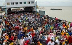 Ferries in Munshiganj's Shimulia and Madaripur's Banglabazar are teeming with large crowds on Saturday, July 31, 2021, despite ongoing lockdown restrictions, after the government announced the reopening of factories from Sunday. Photo: Mahmud Zaman Ovi