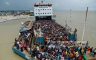A ferry carrying masses of passengers arrives at Munshiganj's Shimulia from Madaripur's Banglabazar on Saturday, July 31, 2021, despite the lockdown. Authorities say that people rush on board the moment the ferries dock. Photo: Mahmud Zaman Ovi