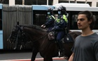 Mounted police patrol the city centre during a law enforcement operation to prevent anti-lockdown protesters from gathering during a lockdown to curb the spread of an outbreak of the coronavirus disease (COVID-19) in Sydney, Australia, July 31, 2021. REUTERS