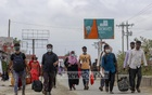 Dhaka-bound workers walked after failing to get a transport from Shimulia ferry terminal in Munshiganj on Saturday, Jul 31, 2021 with factories set to reopen amid the coronavirus lockdown. Photo: Mahmud Zaman Ovi