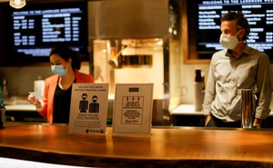 Signs advising about masks and social distancing are pictured by concessions at the Landmark Westwood theatre in Los Angeles, California, US, May 14, 2021. Reuters