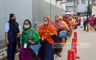 Workers enter a garment factory at Dhaka's Mirpur-11 on Sunday, Aug 1, 2021. Photo: Asif Mahmud Ove