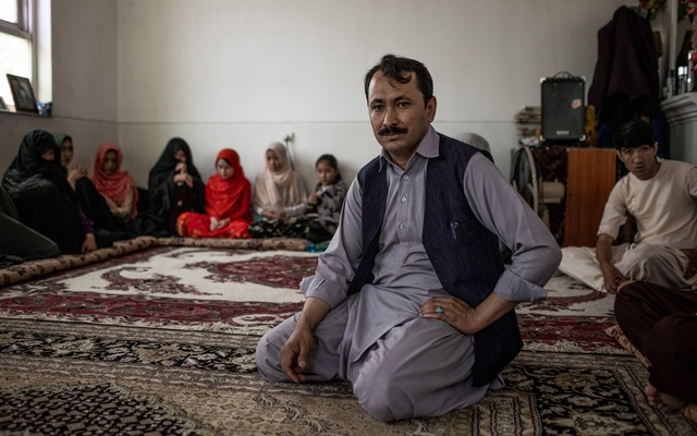 Mohammad Nabi Mohammadi, 40, with displaced people from Malestan, at his home in Kabul, Afghanistan, July 20, 2021. Since the Taliban began their military offensive, at least 30,000 Afghans are fleeing into neighboring countries every week while 230,000 more have been displaced within the country. (Jim Huylebroek/The New York Times)