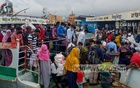 Scores of Dhaka-bound passengers crowd Munshiganj's Shimulia port as launches operate for a limited time to allow workers to return to work, Aug 1, 2021.