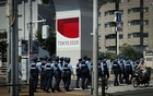 A group of police officers walks outside the Ariake Tennis Park at the Tokyo 2020 Olympic Games in Tokyo, Japan, August 1, 2021. REUTERS