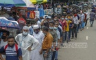 Long lines of migrant workers queue outside the Sheikh Hasina National Burn and Plastic Surgery Institute on Monday, August 2, 2021 as they wait to receive the COVID vaccine. Photo: Mahmud Zaman Ovi