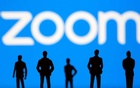Small toy figures are seen in front of Zoom logo in this illustration picture taken March 15, 2021. REUTERS