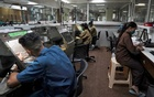 Employees work at a diamond jewellery manufacturing factory in Mumbai, India, Aug 7, 2020. REUTERS
