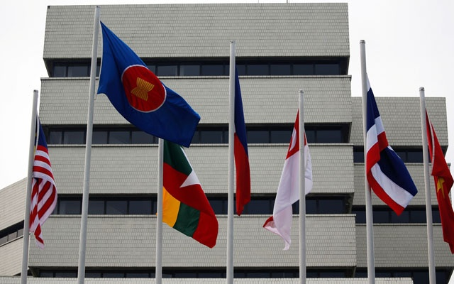 Flags are seen outside the Association of Southeast Asian Nations (ASEAN) secretariat building, ahead of the ASEAN leaders' meeting in Jakarta, Indonesia, April 23, 2021. REUTERS