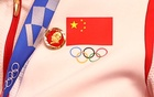 A badge of the late Chinese chairman Mao Zedong is seen pinned to the tracksuit of a China Women's Team Sprint athlete. Tokyo 2020 Olympics - Cycling - Track - Women's Team Sprint - Medal Ceremony - Izu Velodrome, Shizuoka, Japan - August 2, 2021. REUTERS