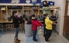Susan Elsamna models how to line up with social distancing for her 1st graders at James Monroe Elementary in Edison, NJ, Nov 3, 2020. The New York Times