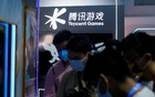 Visitors are seen at the Tencent Games booth during the China Digital Entertainment Expo and Conference, also known as ChinaJoy, in Shanghai, China, July 30, 2021. REUTERS
