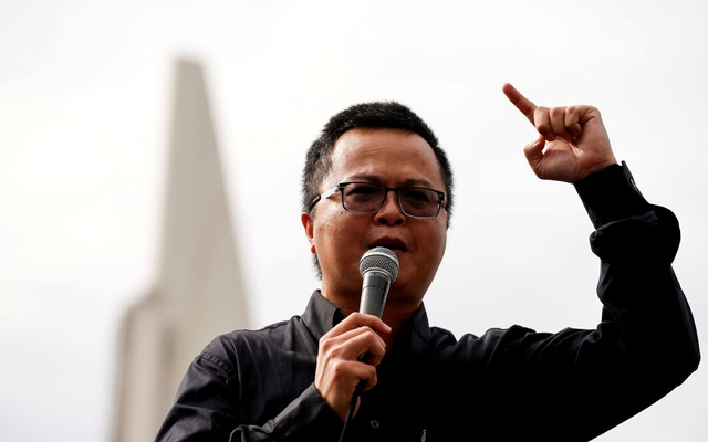 Human rights lawyer Arnon Nampa speaks during a Thai anti-government mass protest, on the 47th anniversary of the 1973 student uprising, in front of the Democracy monument, in Bangkok, Thailand October 14, 2020. REUTERS