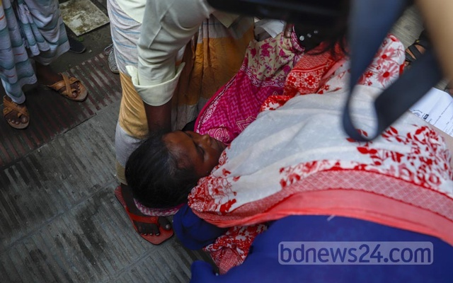 Jharna Aktar fainted while waiting to receive the remains of her daughter Farzana, identified with a single name, at Dhaka Medical College's mortuary on Wednesday, Aug 4, 2021. Farzana was one of the at least 50 victims of Hashem Foods factory fire.